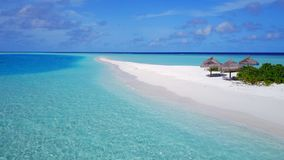 P02364 Aerial flying drone view of Maldives white sandy beach on sunny tropical paradise island with aqua blue sky sea Stock Photos