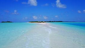 P02380 Aerial flying drone view of Maldives white sandy beach on sunny tropical paradise island with aqua blue sky sea Stock Images