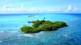 P02282 Aerial flying drone view of Maldives white sandy beach on sunny tropical paradise island with aqua blue sky sea Royalty Free Stock Image