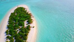 P02432 Aerial flying drone view of Maldives white sandy beach on sunny tropical paradise island with aqua blue sky sea Stock Photo