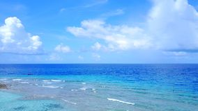 P02375 Aerial flying drone view of Maldives white sandy beach on sunny tropical paradise island with aqua blue sky sea Royalty Free Stock Image