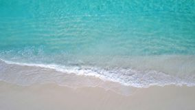 P02704 Aerial flying drone view of Maldives white sandy beach on sunny tropical paradise island with aqua blue sky sea Stock Photos