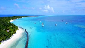P02335 Aerial flying drone view of Maldives white sandy beach on sunny tropical paradise island with aqua blue sky sea Stock Photos