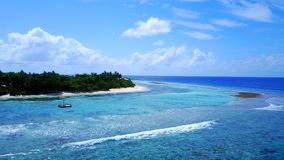 P02336 Aerial flying drone view of Maldives white sandy beach on sunny tropical paradise island with aqua blue sky sea Stock Photography