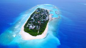 P02347 Aerial flying drone view of Maldives white sandy beach on sunny tropical paradise island with aqua blue sky sea Royalty Free Stock Photos