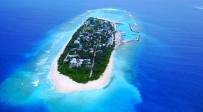 P02277 Aerial flying drone view of Maldives white sandy beach on sunny tropical paradise island with aqua blue sky sea Stock Images