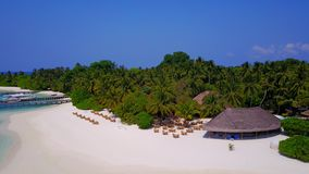 P02235 Aerial flying drone view of Maldives white sandy beach on sunny tropical paradise island with aqua blue sky sea Stock Photos
