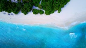 P02239 Aerial flying drone view of Maldives white sandy beach on sunny tropical paradise island with aqua blue sky sea Royalty Free Stock Photography