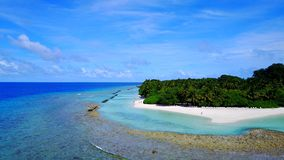 P02288 Aerial flying drone view of Maldives white sandy beach on sunny tropical paradise island with aqua blue sky sea Royalty Free Stock Photo