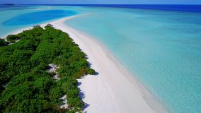 P02233 Aerial flying drone view of Maldives white sandy beach on sunny tropical paradise island with aqua blue sky sea Stock Photography