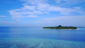P02359 Aerial flying drone view of Maldives white sandy beach on sunny tropical paradise island with aqua blue sky sea Royalty Free Stock Photography