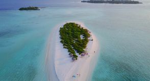P02259 Aerial flying drone view of Maldives white sandy beach on sunny tropical paradise island with aqua blue sky sea Royalty Free Stock Photo