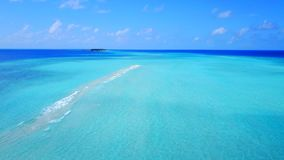 P02416 Aerial flying drone view of Maldives white sandy beach on sunny tropical paradise island with aqua blue sky sea Stock Image