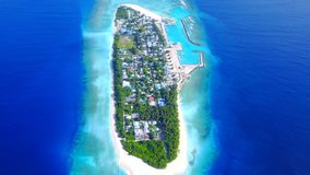 P02480 Aerial flying drone view of Maldives white sandy beach on sunny tropical paradise island with aqua blue sky sea Stock Images