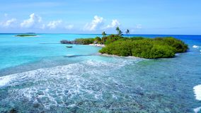 P02485 Aerial flying drone view of Maldives white sandy beach on sunny tropical paradise island with aqua blue sky sea Stock Photos