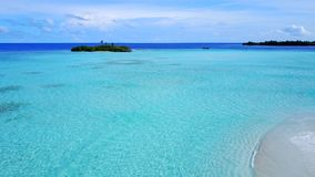 P02237 Aerial flying drone view of Maldives white sandy beach on sunny tropical paradise island with aqua blue sky sea Royalty Free Stock Photography