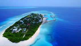 P02379 Aerial flying drone view of Maldives white sandy beach on sunny tropical paradise island with aqua blue sky sea Royalty Free Stock Photos