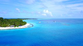P02236 Aerial flying drone view of Maldives white sandy beach on sunny tropical paradise island with aqua blue sky sea Royalty Free Stock Images