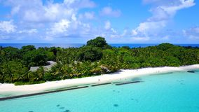 P02494 Aerial flying drone view of Maldives white sandy beach on sunny tropical paradise island with aqua blue sky sea Royalty Free Stock Photo