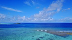 P02365 Aerial flying drone view of Maldives white sandy beach on sunny tropical paradise island with aqua blue sky sea Royalty Free Stock Photography