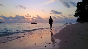 P02066 Aerial flying drone view of Maldives white sandy beach sunrise sunset happy 1 person young beautiful young woman. Aerial flying drone view of Maldives stock images