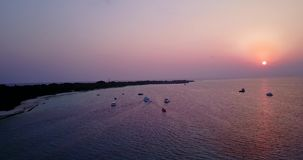 Aerial flying drone view of Maldives white sandy beach sunset sunrise on sunny tropical paradise island with aqua stock video