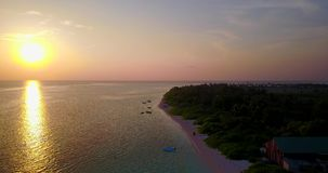 V06503 Aerial flying drone view of Maldives white sandy beach sunset sunrise on sunny tropical paradise island with aqua. Aerial flying drone view of Maldives stock footage