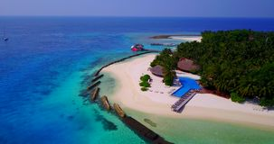 Aerial flying drone view of Maldives white sandy beach swimming pool in luxury 5 star resort hotel relaxing stock video