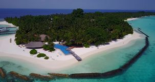 Aerial flying drone view of Maldives white sandy beach swimming pool in luxury 5 star resort hotel relaxing stock footage