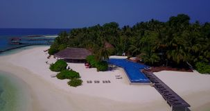 Aerial flying drone view of Maldives white sandy beach swimming pool in luxury 5 star resort hotel relaxing. Holiday vacation on sunny tropical paradise island stock footage