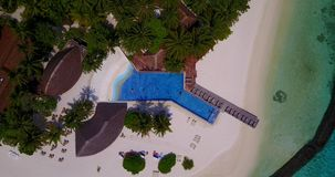 V06679 Aerial flying drone view of Maldives white sandy beach swimming pool in luxury 5 star resort hotel relaxing stock footage