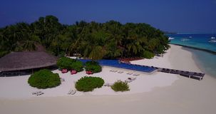 V06750 Aerial flying drone view of Maldives white sandy beach swimming pool in luxury 5 star resort hotel relaxing stock video footage