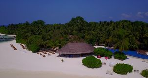 V06691 Aerial flying drone view of Maldives white sandy beach swimming pool in luxury 5 star resort hotel relaxing stock video