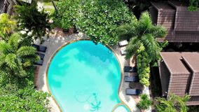 Aerial flying drone view of swimming pool in luxury 5 star resort on sunny tropical paradise island. 1920x1080. Aerial flying drone view of swimming pool in stock video footage