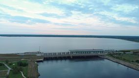 Aerial Flying over the hydroelectric power station on the Daugava River in Riga in the evening stock footage