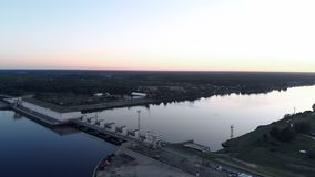 Aerial Flying over the hydroelectric power station on the Daugava River in Riga in the evening sunset stock footage