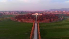 Aerial: flying over Turin countryside, road geometry from above, sunset light, Piedmont, Italy.  stock footage