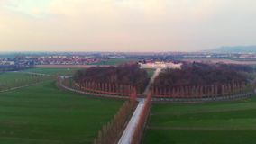 Aerial: flying over Turin countryside, road geometry from above, sunset light, Piedmont, Italy.  stock video footage
