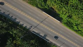 Aerial: Flying up above the Asphalt Road in Thailand. HD. stock video footage
