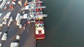 Aerial Flyover of Cargo Ship Being Loading/Unloading Delaware River stock footage