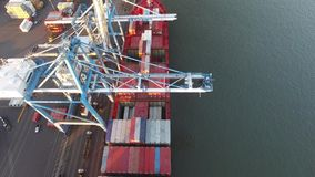 Aerial Flyover of Cargo Ship Being Loading/Unloading Delaware River stock video footage
