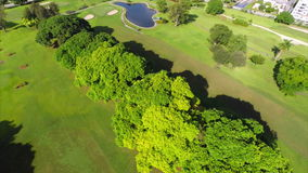 Aerial flyover golf course drone stock footage