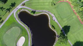 Aerial flyover golf course drone stock video footage