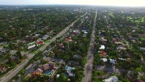 Aerial flyover residential neighborhood stock video footage