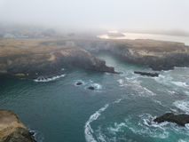 Aerial of Fog-Covered, Rocky Shoreline in Northern California Stock Photos