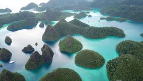 Aerial Footage of Amazing Islands in Wayag, Raja Ampat. Rugged limestone islands, surrounded by coral reefs, are found in an idyllic, tropical lagoon in Wayag stock video