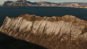 Beautiful cape in the sea. Aerial footage Beautiful cape in the sea stock footage