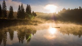 Sunrise Lake Fog Mountains Caumasee Switzeland Aerial 4k. Aerial footage from the beautiful Lake Cauma surrounded by the mountains, located in Flims, Switzerland stock video footage