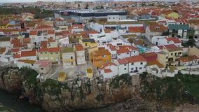 Aerial footage of a beautiful view overlooking the streets and the houses of city Peniche, Portugal. Video in motion.  stock footage