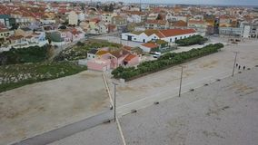 Aerial footage of a beautiful view overlooking the streets and the houses of city Peniche, Portugal. Video in motion.  stock video footage